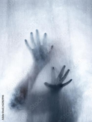 Screaming human pressing through fabric curtain as horror background Canvas Print