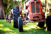 An Old Vintage Red Tractor Sta...