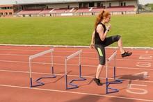 Female Athlete Exercising Over...