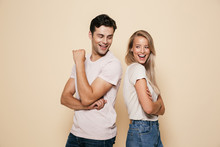 Portrait Of A Smiling Young Couple Standing Together