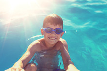 Happy Little Boy Holding Swimm...
