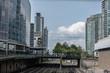 Train tracks running between large buildings inner city