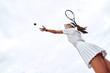 Leinwanddruck Bild - Rear view of tennis woman player serving during a game