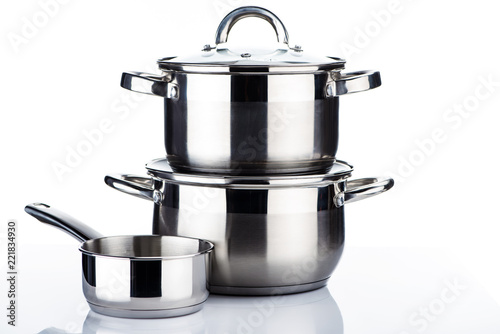 Cuadros en Lienzo close-up view of shiny stainless steel pots and pans on white