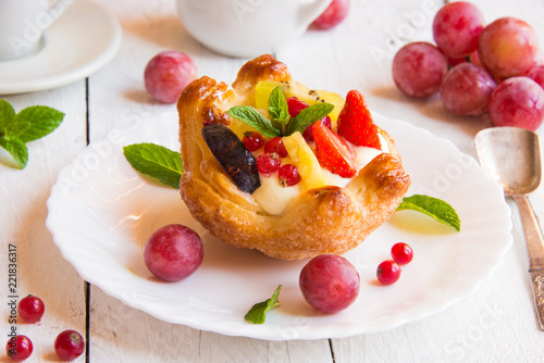 Delicious dessert with cream and fruit
