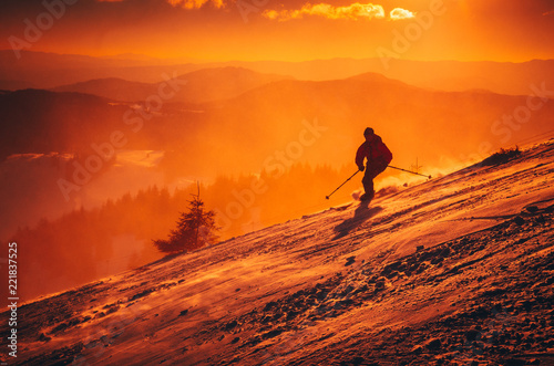 Orange winter sport photo. skier in ski resort