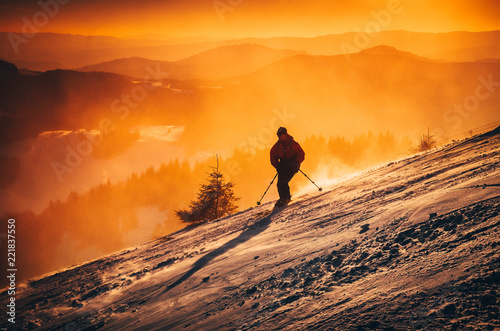 Skier in evening winter nature