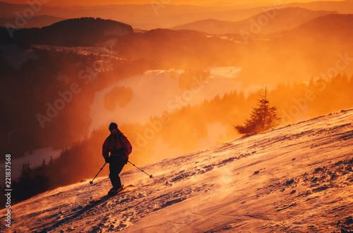 Winter sport photo. Ski in sunset light