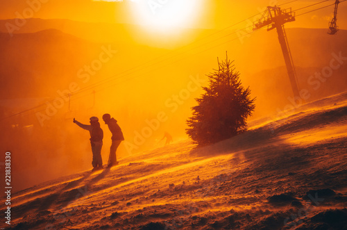 Winter landscape with snowy pine trees and stunning sunset,Carpathians,T