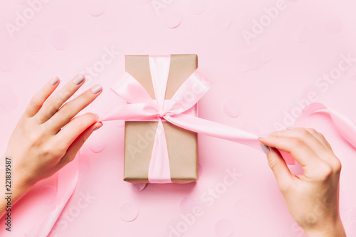 Fotografia, Obraz  Beautiful woman hands with beautiful manicure open gift box.