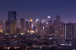 night cityscape metropolis downtown lighting up on skyline
