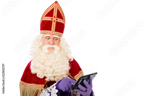 Saint Nicholas looking on tablet or smart phone Tapéta, Fotótapéta