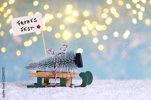 Fotografía  Weihnachtsbaum mit Schlitten holen