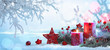 canvas print picture Christmas Decorations With Candles On a Snowy Background