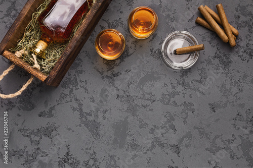 Bottle of aged whiskey gift package shipping with glasses