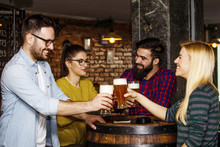 Group Of Four People Toasting ...