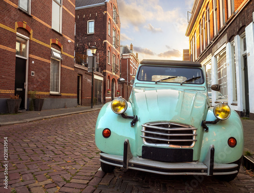 Beautiful retro blue car on the cobbled street of the Dutch city of Vlaardinger Canvas Print
