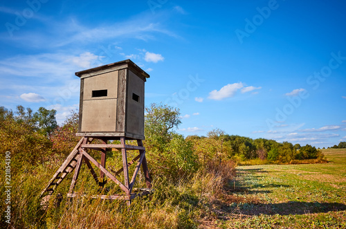 Wooden hunting pulpit in autumn