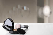 Decorative Composition Of Cosmetics On White Table With Blurred Bath Background. Template For Your Display Product Montage. Space.