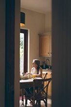 Senior Woman Having Breakfast ...