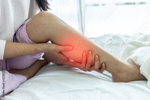 woman have a Calf leg pain and muscle leg pain,Healthcare concept Canvas Print