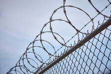 Razor Barbed Wire Against The Sky, Imprisonment Concept.