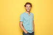 Leinwanddruck Bild - Young man in casual clothes posing on color background