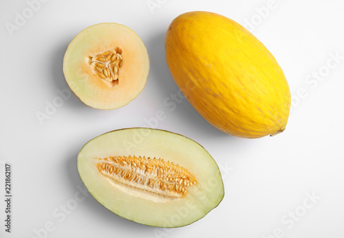 Flat lay composition with melons on white background