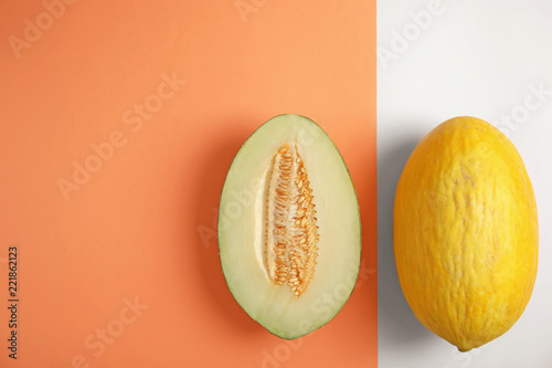 Flat lay composition with melons and space for text on color background