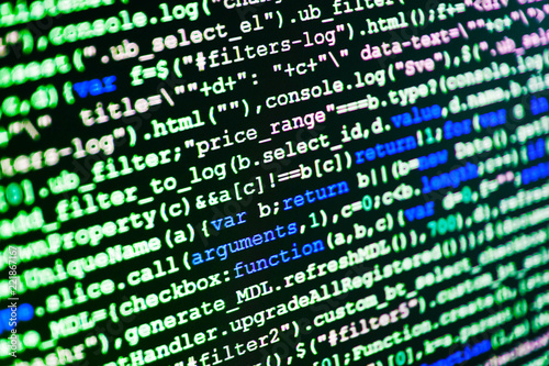 Writing programming code on laptop  CSS, JavaScript and HTML