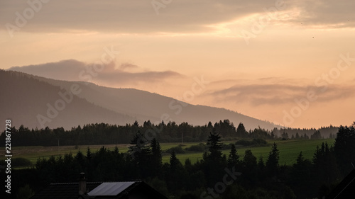 Poster de jardin Parc Naturel panoramic view of misty forest in western carpathian mountains. Tatra in foggy sunset