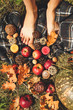 Autumn composition. Layout on a straw background with apples, pumpkin, fallen leaves and candles