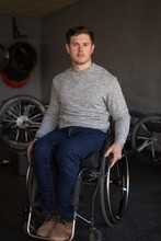 Disabled Man In Wheelchair At Workshop