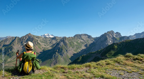 hiker woman resting a moment and looking a mountains Canvas