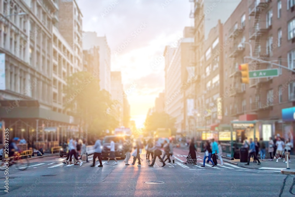 Fototapety, obrazy: Diverse crowd of people walking across the busy intersection of 23rd Street and 6th Avenue in Manhattan New York City with the colorful light of sunset in the background