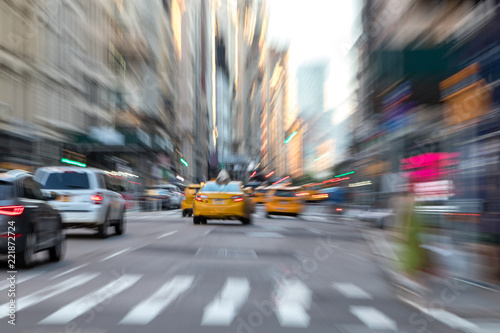 Deurstickers New York City Abstract blurred scene with taxis in motion through the streets of New York City