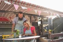Couple Working Near Food Truck