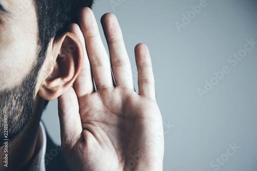 Fotografia  young man hand on the ear