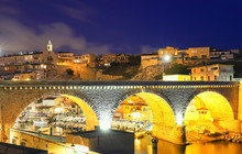 Harbor At Vallon Des Auffes With The Famous Old Bridge In Marseille At Night, France.