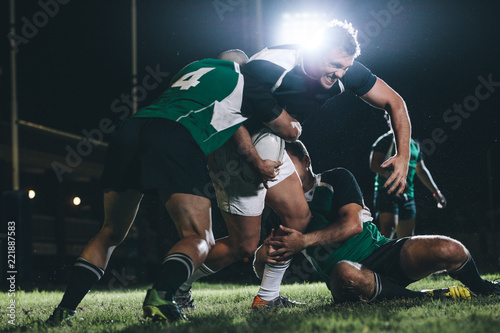 Rugby player trying to escape the tackle
