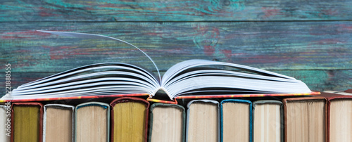 Vászonkép Open book hardback on Stack books