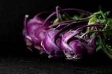 Purple Kohlrabi On A Black Background..