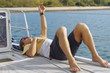 Man lying on deck of sailboat, Lombok, Indonesia