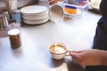 Female Waiter Preparing Coffee In Food Truck