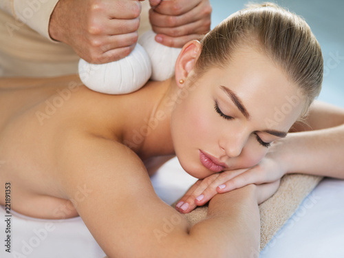 Woman getting massage with hot stones