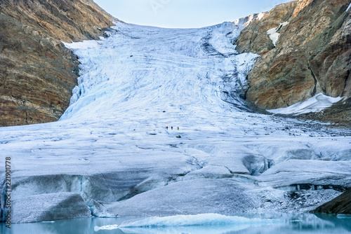 Three people climbing the Steindalsbreen Glacier in North Norway - tourist attractions in Scandinavia