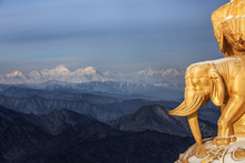 Emeishan, Mount Emei, Sichuan Province China. Sacred Buddhist Mountain. Snow Covered Mountain, Golden Elephant Statue, Shrine. Winter Scenery, Ice And Snow. Gongga Snow Mountain In The Distance