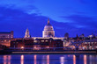 St. Paul's Cathedral Light up at Twilight with Millennium Bridge and Light Trail of Boat in Thames River