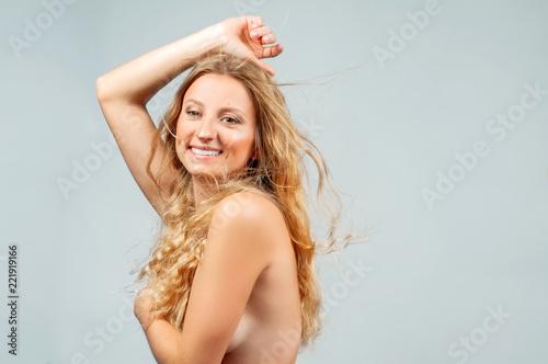 Deurstickers Akt Beautiful woman with wavy long blonde hair.