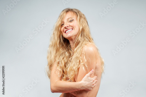 Tuinposter Akt Beautiful woman with wavy long blonde hair.